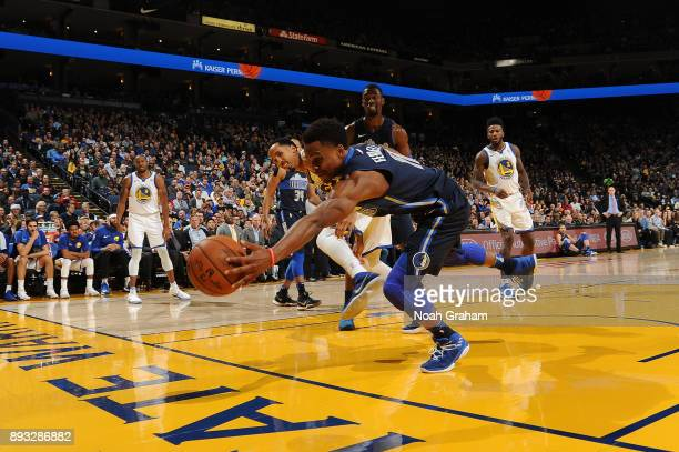 Yogi Ferrell of the Dallas Mavericks goes for the loose ball against the Golden State Warriors on December 14 2017 at ORACLE Arena in Oakland...