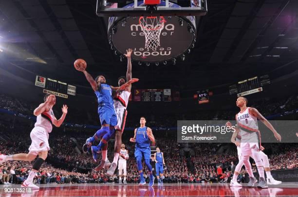 Yogi Ferrell of the Dallas Mavericks goes to the basket against the Portland Trail Blazers on January 20 2018 at the Moda Center in Portland Oregon...