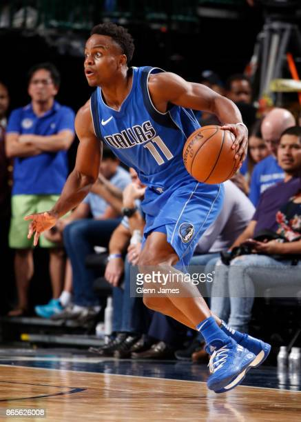 Yogi Ferrell of the Dallas Mavericks handles the ball against the Golden State Warriors on October 23 2017 at the American Airlines Center in Dallas...