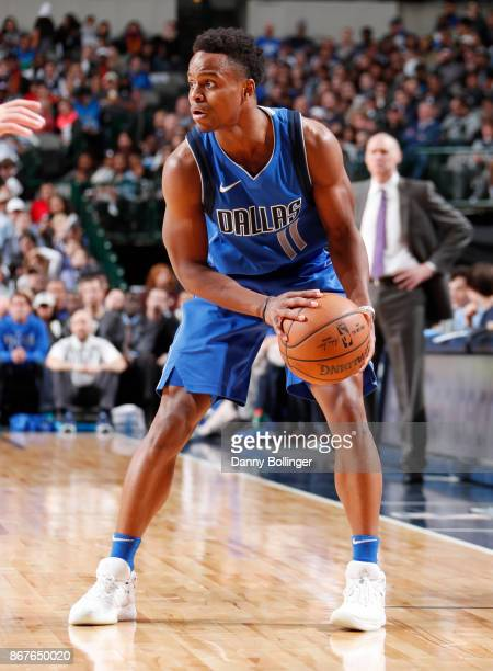 Yogi Ferrell of the Dallas Mavericks handles the ball against the Philadelphia 76ers on October 28 2017 at the American Airlines Center in Dallas...