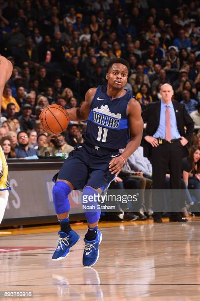 Yogi Ferrell of the Dallas Mavericks handles the ball against the Golden State Warriors on December 14 2017 at ORACLE Arena in Oakland California...