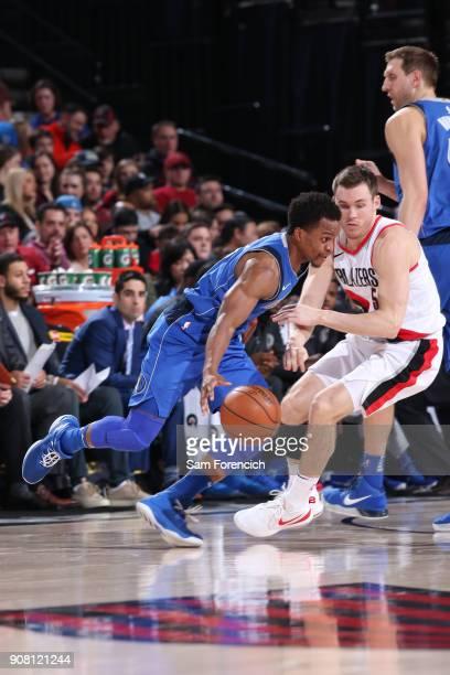 Yogi Ferrell of the Dallas Mavericks handles the ball against the Portland Trail Blazers on January 20 2018 at the Moda Center in Portland Oregon...
