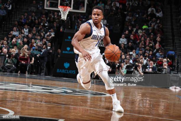 Yogi Ferrell of the Dallas Mavericks handles the ball against the Brooklyn Nets on March 17 2018 at Barclays Center in Brooklyn New York NOTE TO USER...