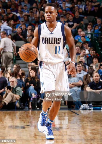 Yogi Ferrell of the Dallas Mavericks handles the ball during a game against the Oklahoma City Thunder on March 27 2017 at American Airlines Center in...