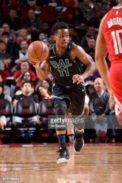 Yogi Ferrell of the Dallas Mavericks handles the ball during the game against the Houston Rockets on February 11 2018 at the Toyota Center in Houston...