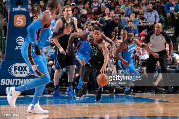 Yogi Ferrell of the Dallas Mavericks handles the ball during the game against the Oklahoma City Thunder on February 28 2018 at the American Airlines...