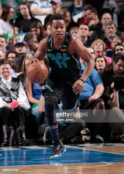 Yogi Ferrell of the Dallas Mavericks handles the ball during the game against the Denver Nuggets on March 6 2018 at the American Airlines Center in...