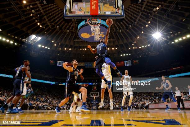 Yogi Ferrell of the Dallas Mavericks shoots the ball against the Golden State Warriors on December 14 2017 at ORACLE Arena in Oakland California NOTE...
