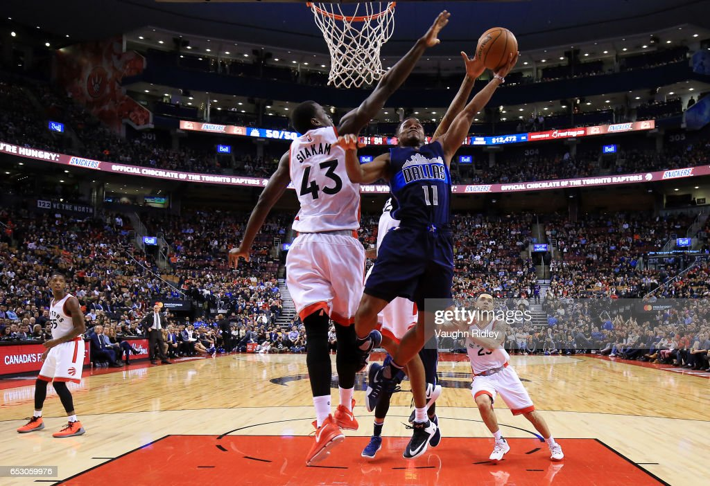 Yogi Ferrell #11 of the Dallas Mavericks shoots the ball as Pascal Siakam #43 of the Toronto Raptors defends during the first half of an NBA game at Air Canada Centre on March 13, 2017 in Toronto, Canada.