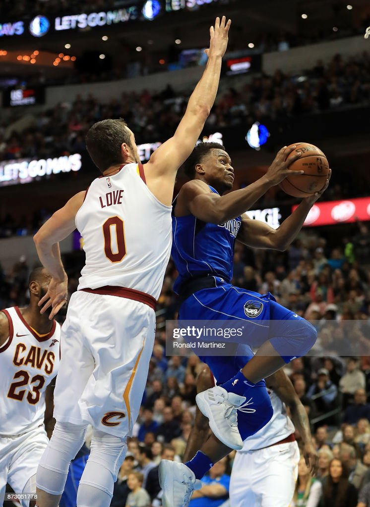 Yogi Ferrell #11 of the Dallas Mavericks takes a shot against Kevin Love #0 of the Cleveland Cavaliers in the first half at American Airlines Center on November 11, 2017 in Dallas, Texas.