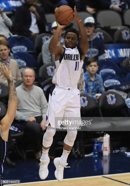 Yogi Ferrell of the Dallas Mavericks takes a shot against the Orlando Magic in the second half at American Airlines Center on January 9 2018 in...