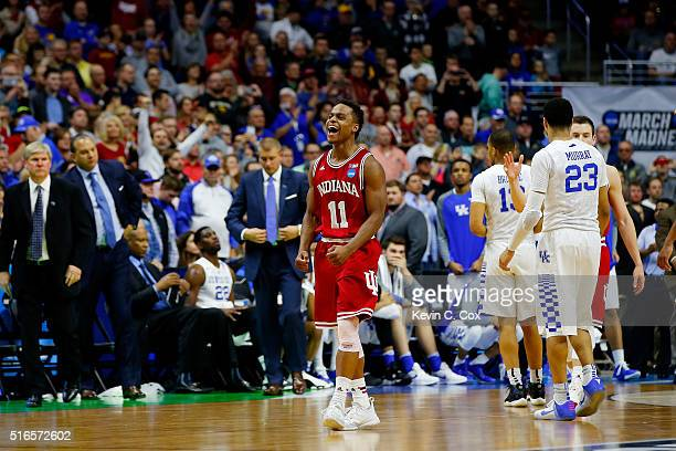Yogi Ferrell of the Indiana Hoosiers celebrates defeating Kentucky Wildcats 73 to 67 during the second round of the 2016 NCAA Men's Basketball...