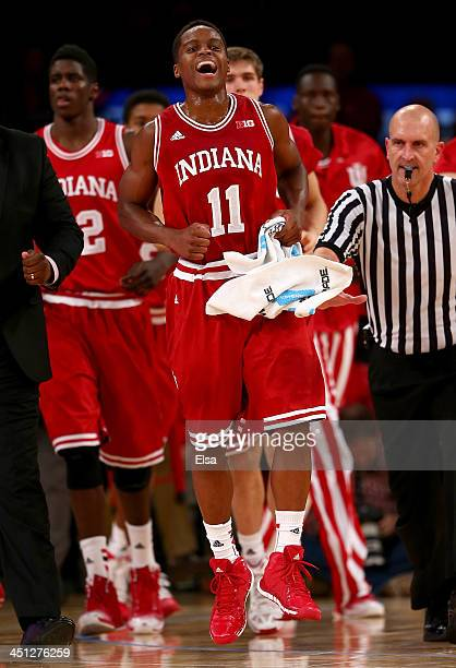 Yogi Ferrell of the Indiana Hoosiers celebrates in the second half against the Washington Huskies during the 2K Sports Classic at Madison Square...