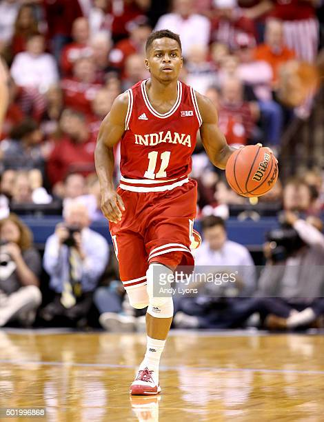 Yogi Ferrell of the Indiana Hoosiers dribbles the ball against the Notre Dame Fighting Irish during the Crossroads Classic at Bankers Life Fieldhouse...