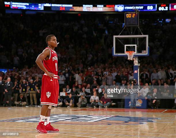 Yogi Ferrell of the Indiana Hoosiers looks on in the final second of the game as the officials determine the exact time that is left on the shot...