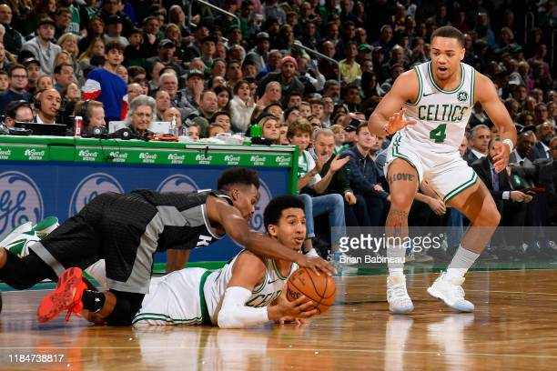 Yogi Ferrell of the Sacramento Kings and Tremont Waters of the Boston Celtics go after the ball during the game against the Sacramento Kings on...