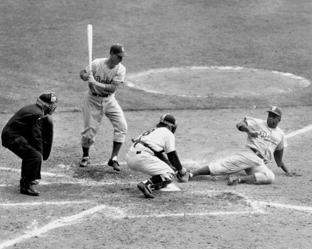 Yogi has it Out. Jackie Robinson, with two out in the eighth