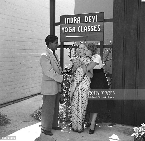 Yogi Indra Devi is hugged by her student at her studio in HollywoodCalifornia