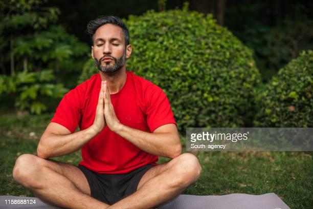 yogi meditating - deep stock pictures, royalty-free photos & images