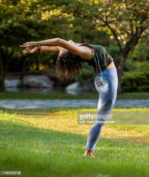 yogi woman in ardha chakrasana pose - good posture stock pictures, royalty-free photos & images