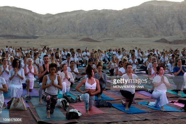 Yogis, Israeli and foreigners, participate in the Arava Yoga Annual festival at the ancient copper mines area of the Timna Valley, in the southern...