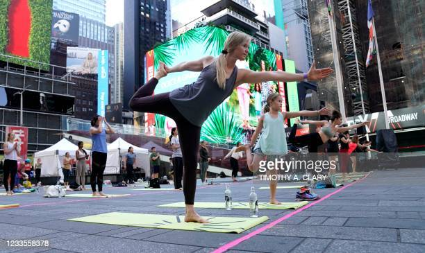 Yogis take part as Times Square Alliance hosts Solstice in Times Square: Mind Over Madness Yoga, June 20 an annual all-day outdoor yoga event in the...