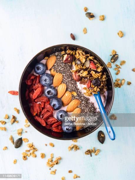 yogurt smoothie bowl with berries, chia, granola - 抗酸化物質 ストックフォトと画像