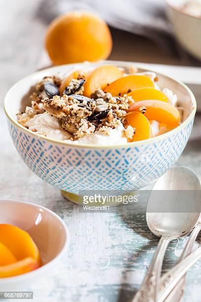 Yogurt with crunchy muesli and fresh apricot