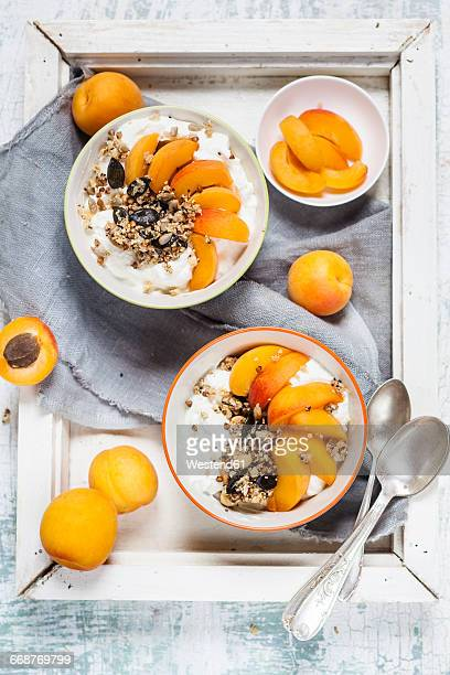Yogurt with crunchy muesli and fresh apricot