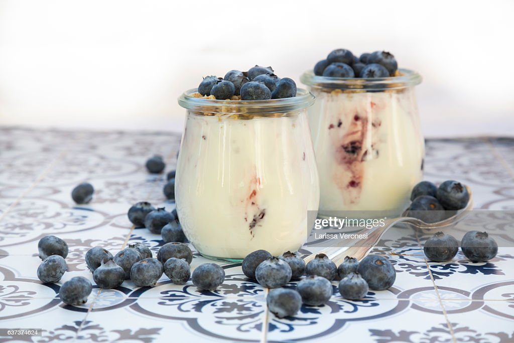 Yogurt with granola and blueberries : Stock Photo