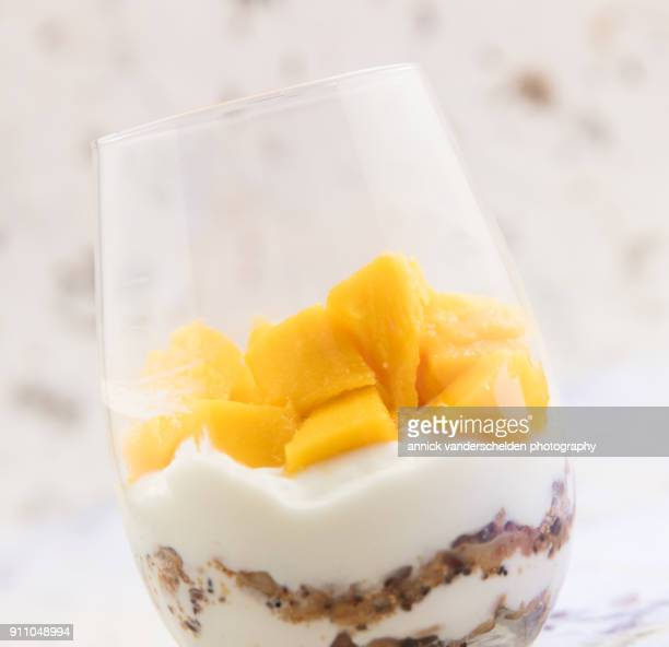 Yogurt with granola and mango.