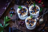 Yogurt with granola, berry fruits and chocolate