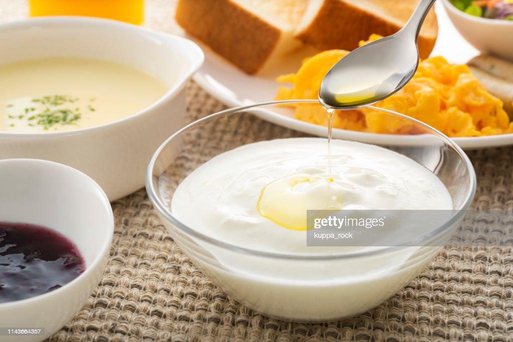 Yogurt with olive oil : Stock Photo