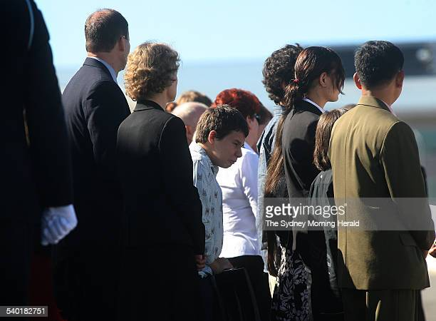 Yogyakarta Plane Crash Family and friends of crash victim Allison Sudradjat watch as her coffin is carried from the RAAF Hercules by an honour guard...