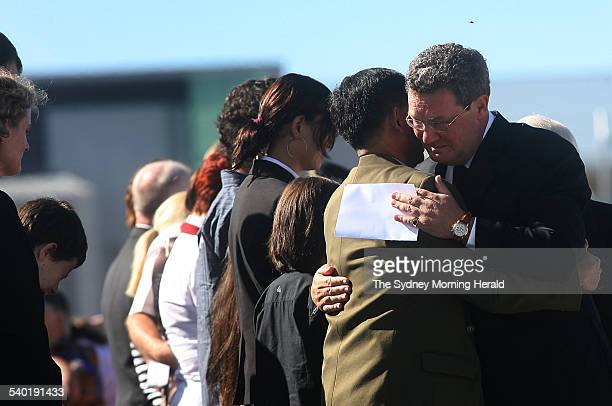 Yogyakarta Plane Crash Federal Foreign Affairs Minister Alexander Downer consoles the husband of crash victim Allison Sudradjat during the...