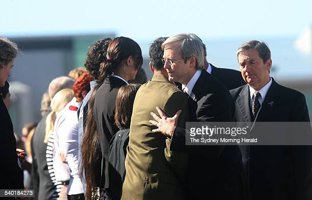 Yogyakarta Plane Crash Federal Opposition leader Kevin Rudd consoles the husband of crash victim Allison Sudradjat during the repatriation ceremony...