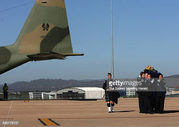 Yogyakarta Plane Crash The coffin of crash victim Allison Sudradjat is carried from the RAAF Hercules by an honour guard during the repatriation...