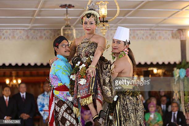 Yogyakarta Sultan Hamengkubuwono X's fourth daughter Princess Hayu is carried by her groom Prince Notonegoro and uncle Suryodiningrat during the...