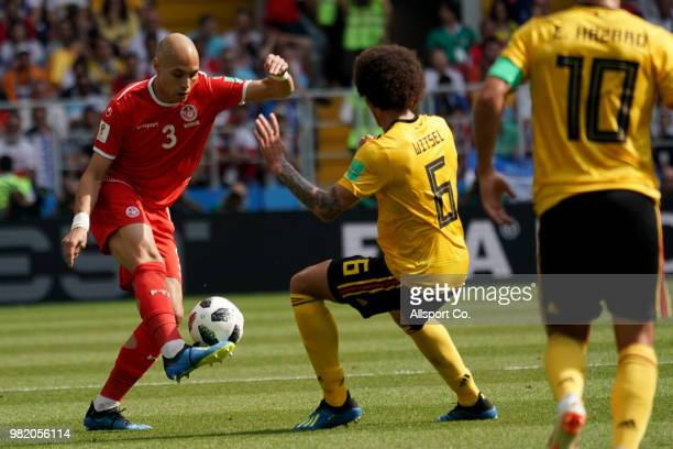 Yohan Ben Alouane of Tunisia battles with Axel Witsel of Belgium during the 2018 FIFA World Cup Russia group G match between Belgium and Tunisia at...