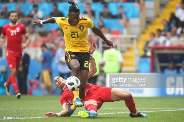 Yohan Ben Alouane of Tunisia challenges Michy Batshuayi of Belgium during the 2018 FIFA World Cup Russia group G match between Belgium and Tunisia at...