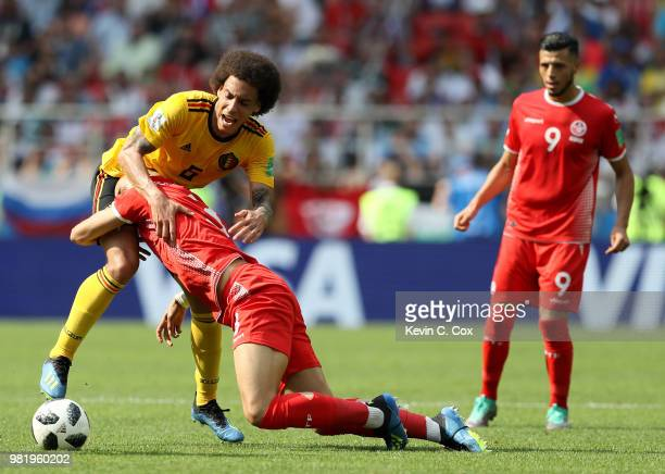 Yohan Ben Alouane of Tunisia tackles Axel Witsel of Belgium during the 2018 FIFA World Cup Russia group G match between Belgium and Tunisia at...