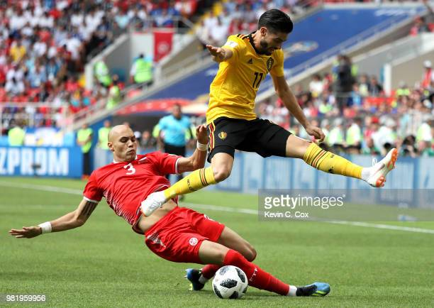 Yohan Ben Alouane of Tunisia tackles Yannick Carrasco of Belgium during the 2018 FIFA World Cup Russia group G match between Belgium and Tunisia at...