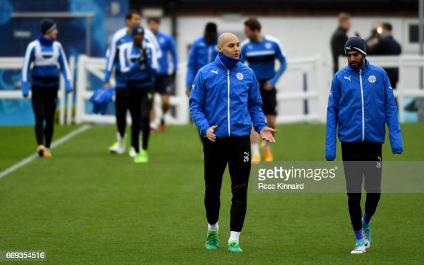 Yohan Benalouane and Riyad Mahrez of Leicester City arrive for a training session at their Belvoir drive traning centre prior to the Champins League...