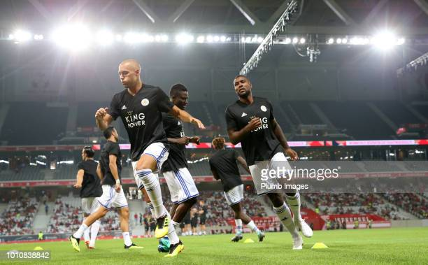 Yohan Benalouane and Wes Morgan of Leicester City warm up ahead of the preseason friendly match between Lille and Leicester City at Stade Pierre...