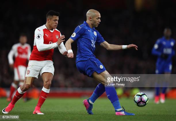 Yohan Benalouane of Leicester City and Alexis Sanchez of Arsenal in action during the Premier League match between Arsenal and Leicester City at the...