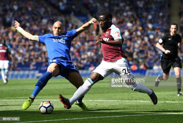 Yohan Benalouane of Leicester City and Arthur Masuaku of West Ham United battle for possession during the Premier League match between Leicester City...