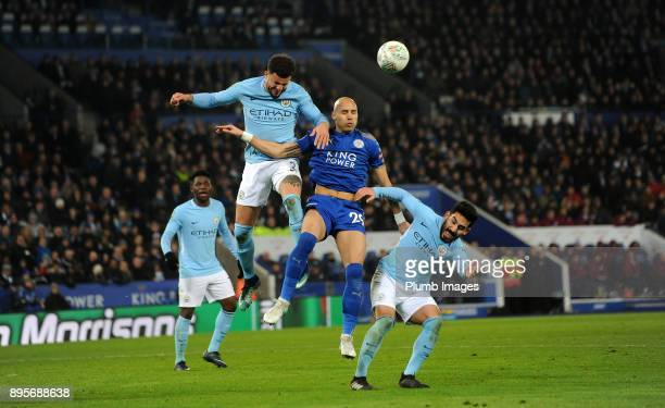 Yohan Benalouane of Leicester City in action with Kyle Walker of Manchester City during the Carabao Cup QuarterFinal match between Leicester City and...