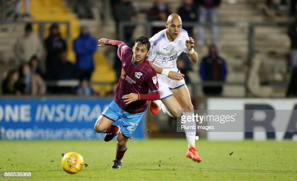Yohan Benalouane of Leicester City in action with Levi Sutton of Scunthorpe United during the Checkatrade Trophy tie between Scunthorpe United and...