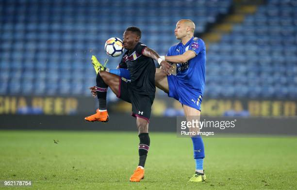 Yohan Benalouane of Leicester City in action with Rushian HepburnMurphy of Aston Villa during the Premier League Cup Semi Final tie between Leicester...
