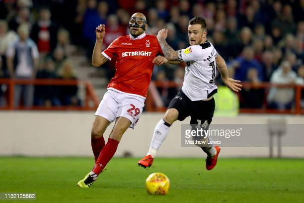 Yohan Benalouane of Nottingham Forest is challenged by Jack Marriott of Derby County Sky Bet Championship match between Nottingham Forest and Derby...